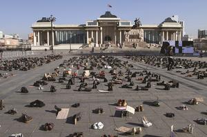 Thousands of empty shoes stand in for protesters
